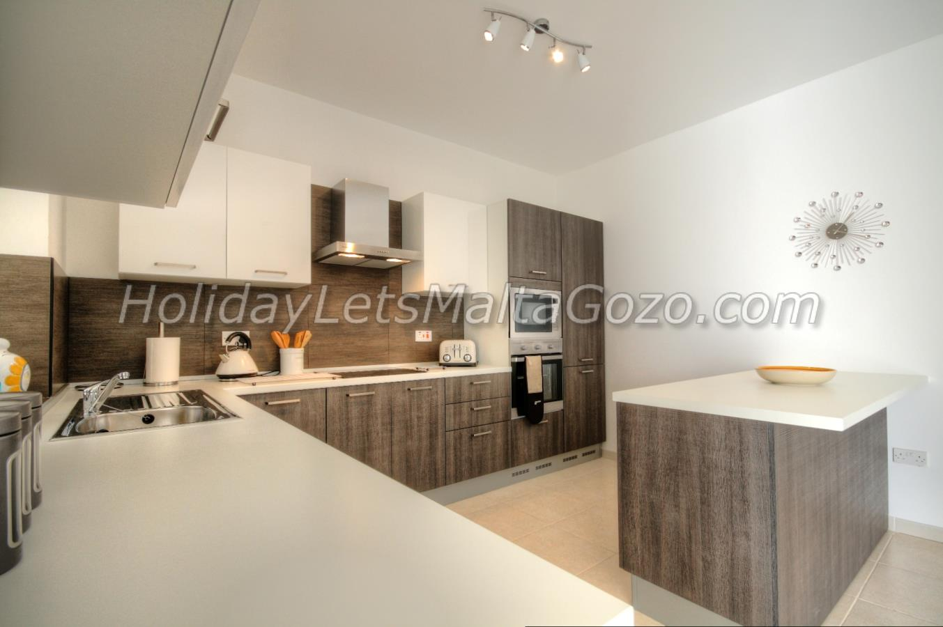 Large modern kitchen with breakfast bar