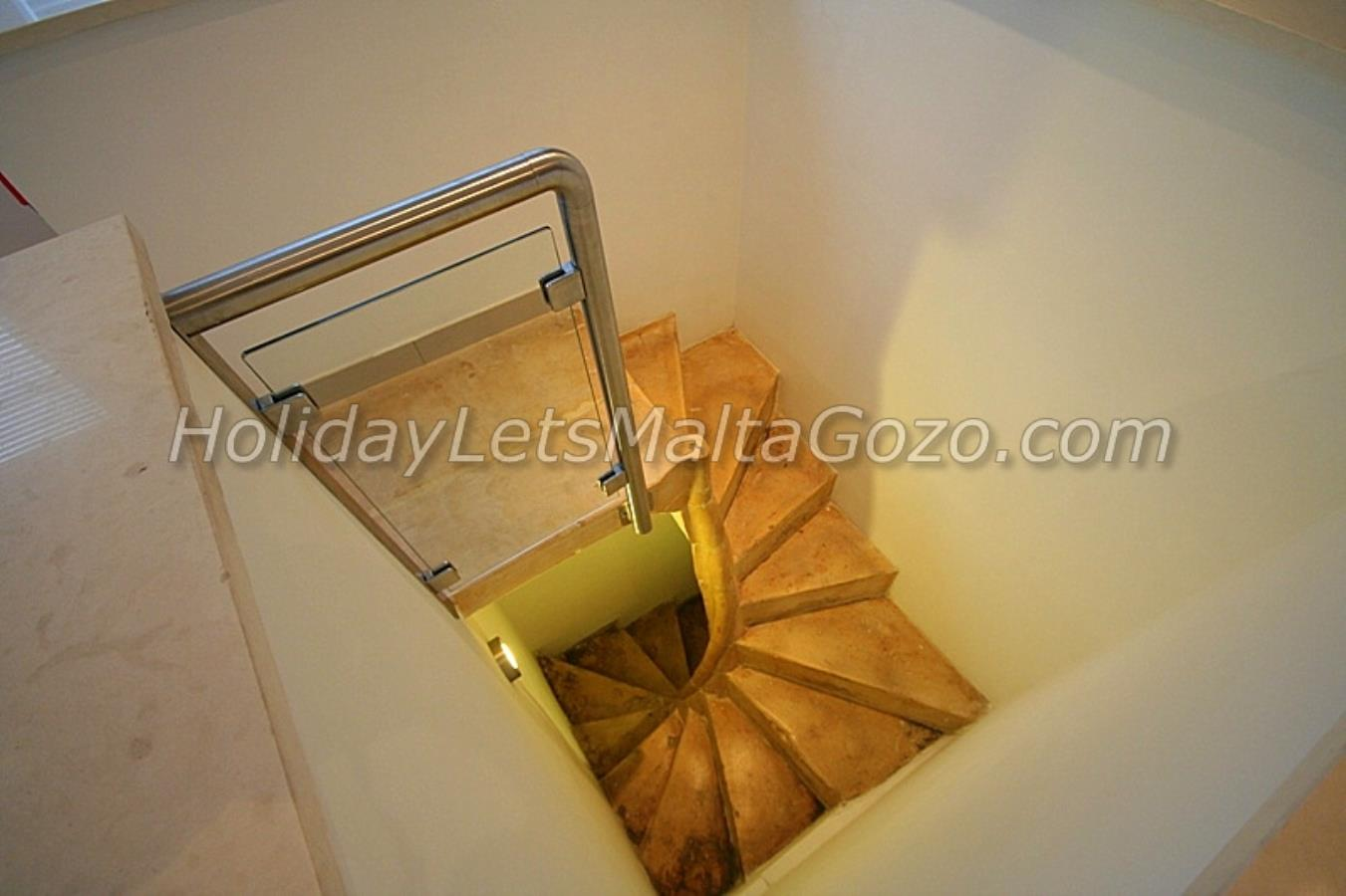 Spiral Staircase to Double Bedroom at Lower Level